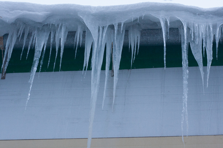 icicles on the house. many icicles thaw. fot horizontal for your design