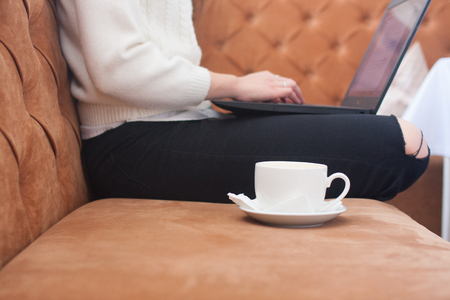 girl with a laptop and a cup of coffee. work online. horizontal photo for your design Stock Photo