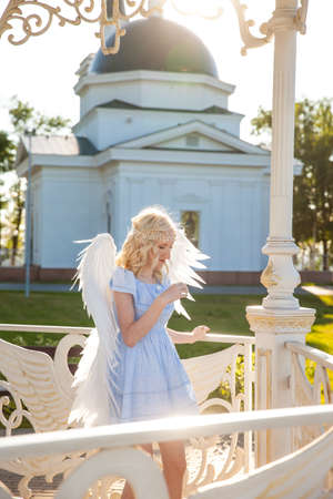 Angel girl with large white feather wings