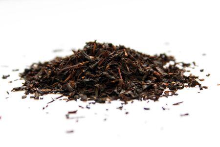 Black tea on a white background. Tea leaves.