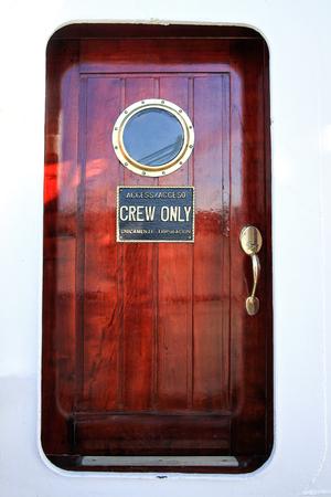 mahogany: red cabin door mahogany ship with portholes