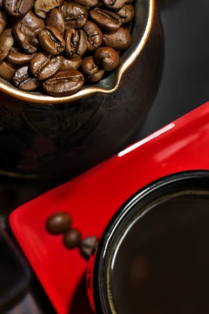 red cup: Turk coffee with coffee beans and red cup of coffee