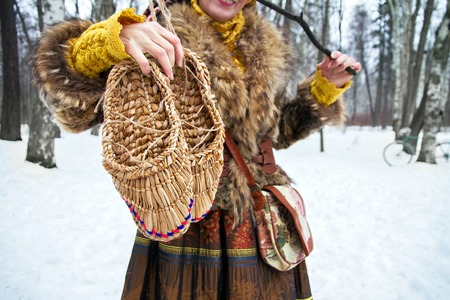 bast: Bast shoes are handmade in the hand of a woman Stock Photo