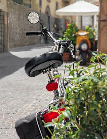 Bike on the summer sun street of Rome, Italy