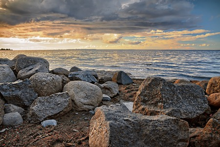 Sunset on the shore of Finnish Gulf stone