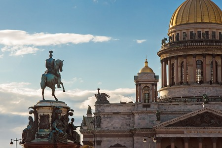 nikolay: Gold dome of St. Isaacs Cathedral in Saint-Petersburg, Monument to Nikolay the First Stock Photo