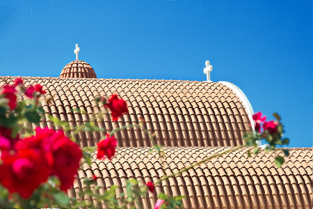 Orange roof tiles of the Orthodox Church in Cyprus Stock Photo