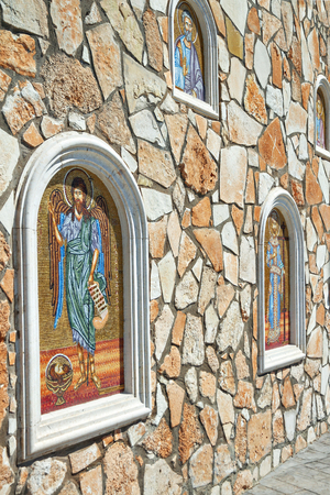 Wall with mosaic icons next to the Greek church of Our Lady, Cyprus