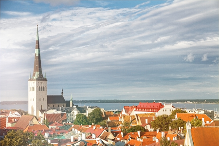 View of Tallinn Old Town, Baltic Sea and St. Olaf in a summer day, Estonia Stock Photo