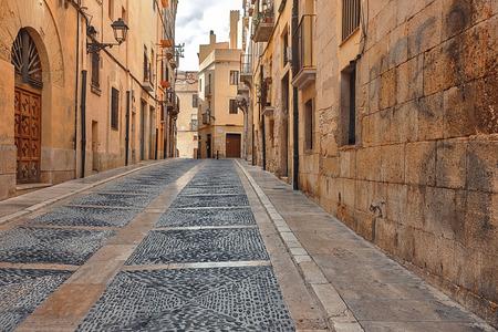 vista street with gray pavement bridge of ancient Spain city Tarragona on the Mediterranean coast