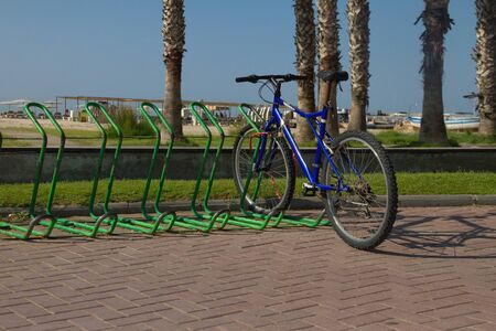 one cyclist is parked on the beach of the Mediterranean coast on a sunny day in Spain, Salou, Europe