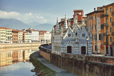 Gothic church Santa Maria della Spina in the city of Pisa in Italy on the embankment of the Arno River Фото со стока