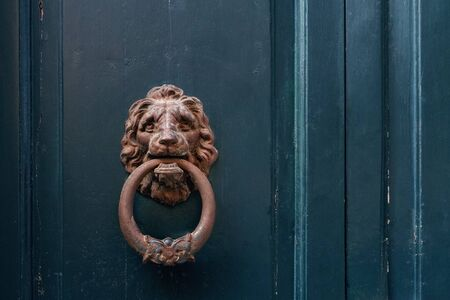 wooden old blue door and handle in wrought iron, copy space