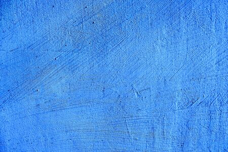 blue paint texture of old building wall with scratches and scuffs