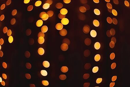 Abstract background with yellow bokeh defocused lights and stars of old lens