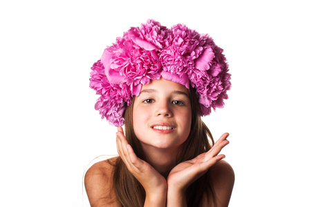 flower head: Girl with wreath of pink flowers on isolated white background Stock Photo