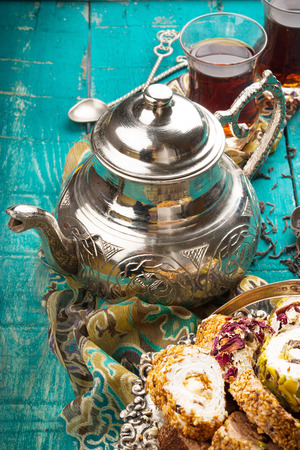 delight: Tea and turkish delight on wooden background Stock Photo