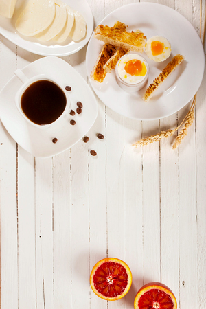 Breakfast with eggs and coffee on a white background.
