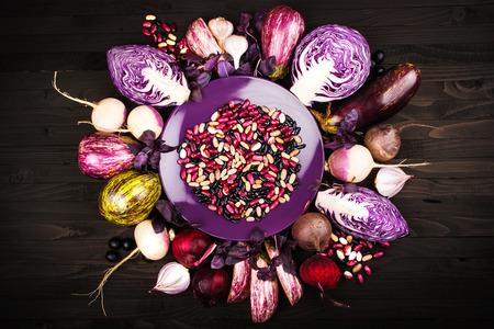 purple leaf plum: Purple vegetables on a wooden background