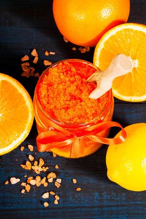 Homemade sugar scrub with Orange on a wooden background Фото со стока