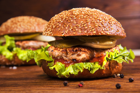 homemade style: Homemade burger on a wooden background. Rustic style Stock Photo