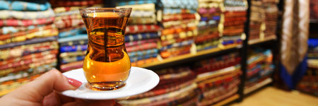 bedspread: A glass of Turkish tea against the background of Turkish textiles. Turkey, Istanbul.