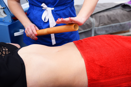 Non surgical body sculpting. Anti-cellulite and anti-fat therapy in beauty salon. 写真素材