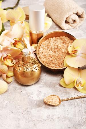 Golden spa concept with orchid, shells, sea salt. Top view. Stock fotó