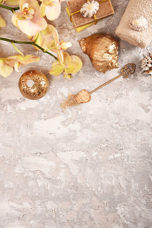Golden spa concept with orchid, shells, sea salt. Top view. Zdjęcie Seryjne