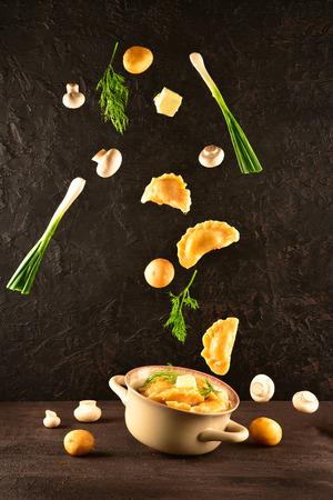 Levitating food. Pierogi. Dumplings with potatoes and mushrooms are flying. Ready meal. Stok Fotoğraf