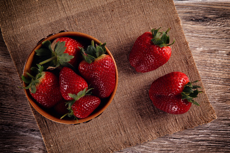 Strawberry in a clay bowl