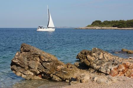 Dalmatian seascape with a yacht sailing