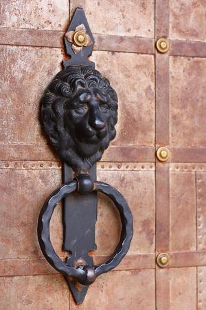 knocker: Old style lions head knocker  Stock Photo