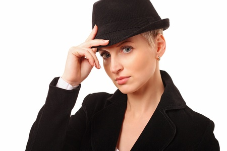 Portrait of a beautiful woman with a hat over white