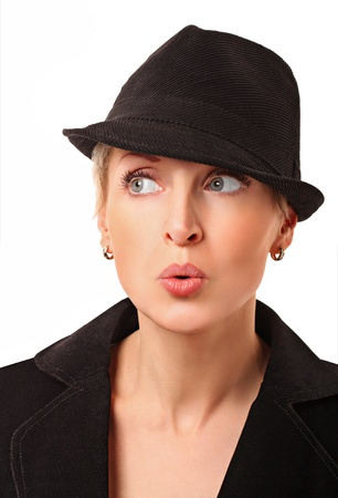 Portrait of a beautiful surprised woman with a hat over white