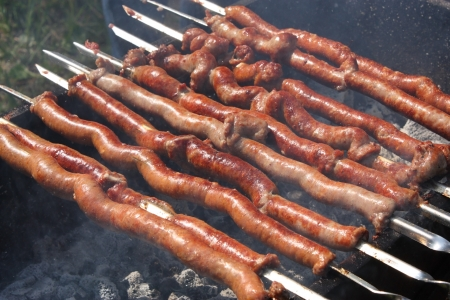 SAUSAGES ON SKEWERS on summer day