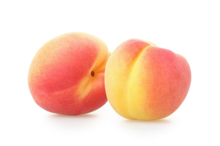 Two whole apricots on white background Stock Photo