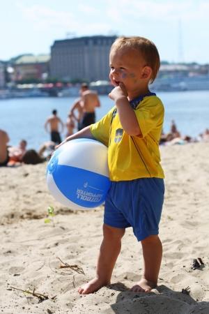 Swede boy-fan is in the fan camping site on the Trukhanov Island 19, 2012 in Kiev, Ukraine.