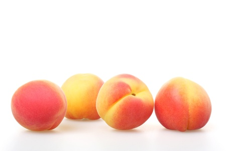 Group of whole apricots on white background Stock Photo