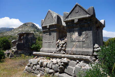 Ancient ruins with burial sarcophagi in Lycian city of Sidyma known in Mugla province, Turkey
