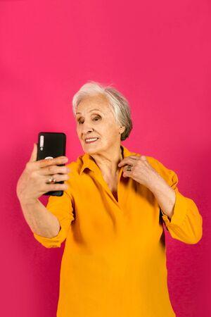 senior woman taking selfie photo with snatphone