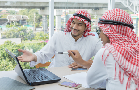 Two Arabian businessman talking agreement business contract
