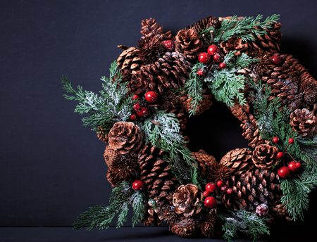 Christmas wreath on dark background with copyspace