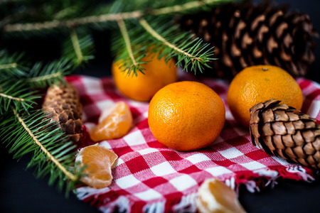 Tangerines with christmas decoration on rustic wooden background. Tangerines with spruce. Christmas decoration. Copy space