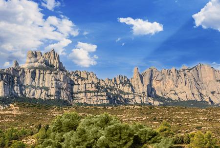 The Mountain of Montserrat (Catalonia, Spain). Montserrat mountains and Benedictine monastery of Santa Maria de Montserrat. Stock Photo