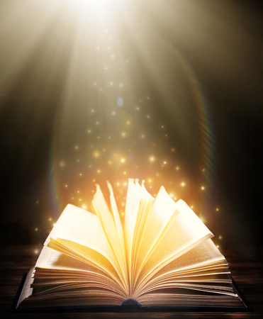 Mystical old book. Open old book indoor. A fairy tale Stock Photo