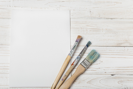 Art and craft tools.Artist's brush, canvas. Wooden art palette with tubes of acrylic paints.Artist's workshop.Art picture with copy space and for add text.Artist workplace background.Paints brushes Banco de Imagens