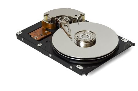disassemble: Disassembled hard disc isolated on white