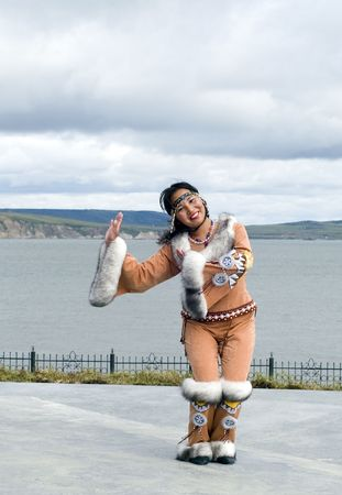 Dancing chukchi woman in the folk clothes
