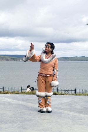 eskimo woman: Chukchi woman looks at the mirror (position of the folk dance)